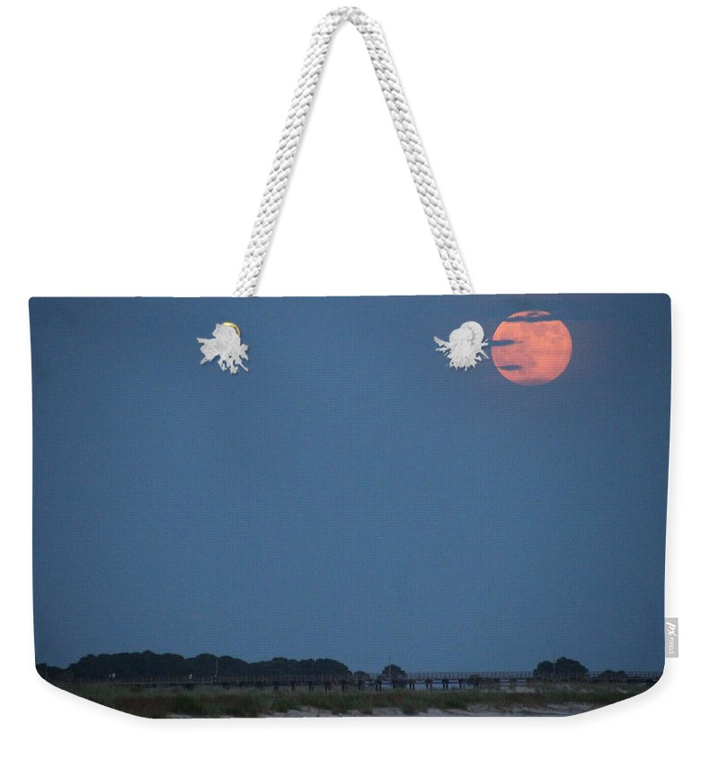 Moon Weekender Tote Bag featuring the photograph Supermoon Rising by Laura Martin