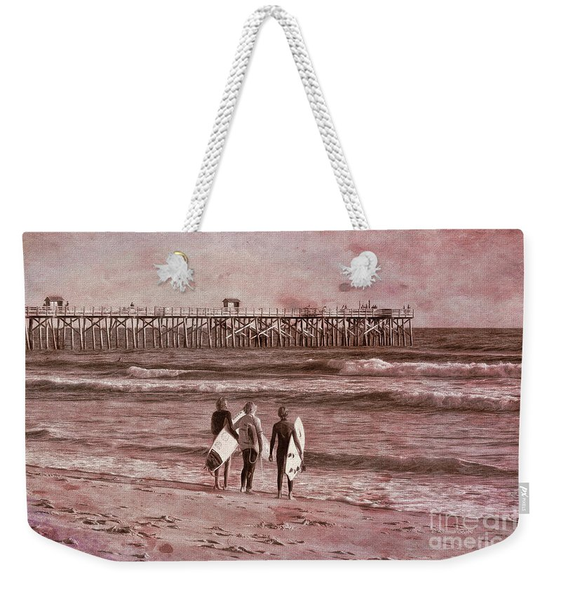 Florida Weekender Tote Bag featuring the photograph Surfers Three by Deborah Benoit