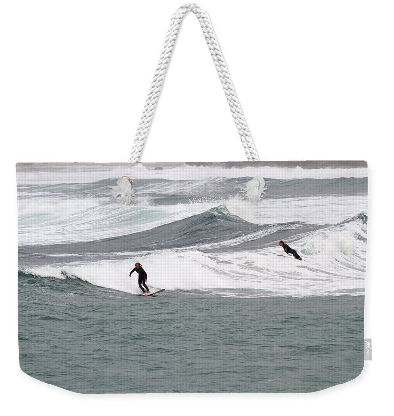Action Weekender Tote Bag featuring the photograph Surfing At Sennen Cove Cornwall by Chris Smith