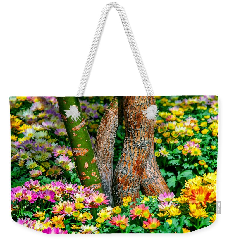 Spring Flowers Weekender Tote Bag featuring the photograph Surrounded by Az Jackson