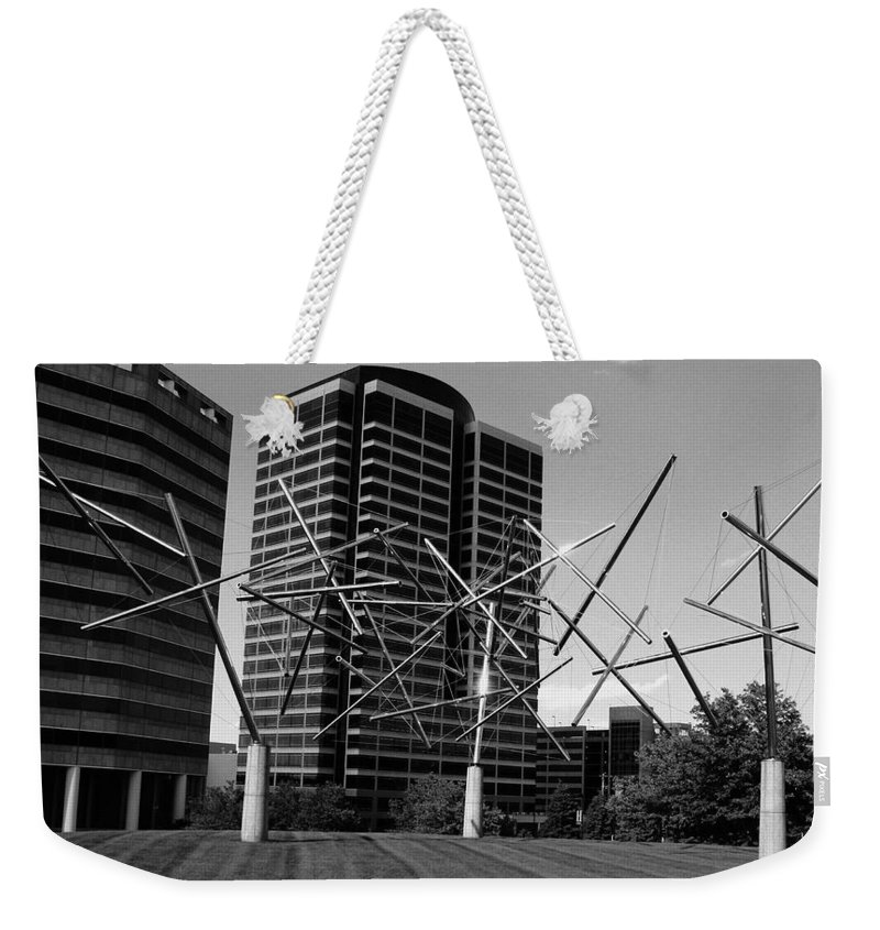 Metal Weekender Tote Bag featuring the photograph Suspended by Angus Hooper Iii