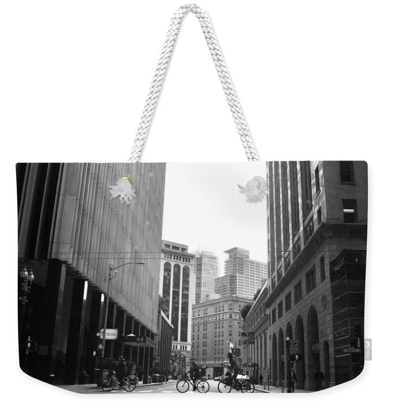 City Weekender Tote Bag featuring the photograph Sutter Street Cyclists - San Francisco Street View Black And White by Matt Harang