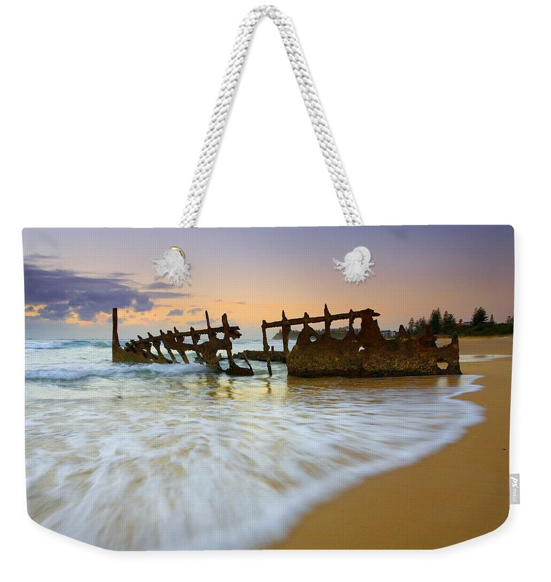 Shipwreck Weekender Tote Bag featuring the photograph Swallowed By The Tides by Mike Dawson