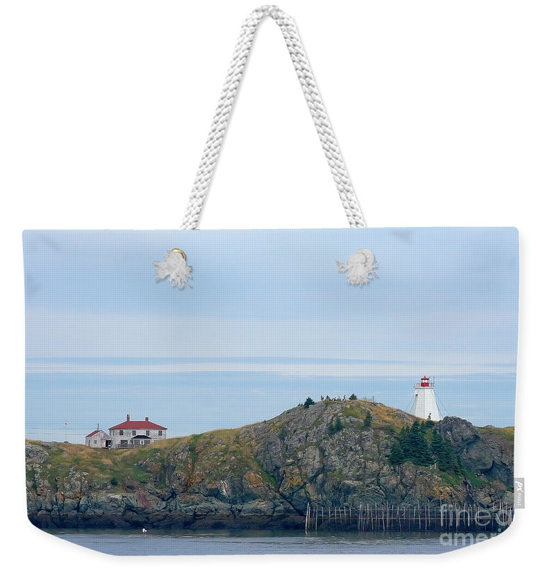 Lighthouse Weekender Tote Bag featuring the photograph Swallowtail Lighthouse And Keeper by Thomas Marchessault