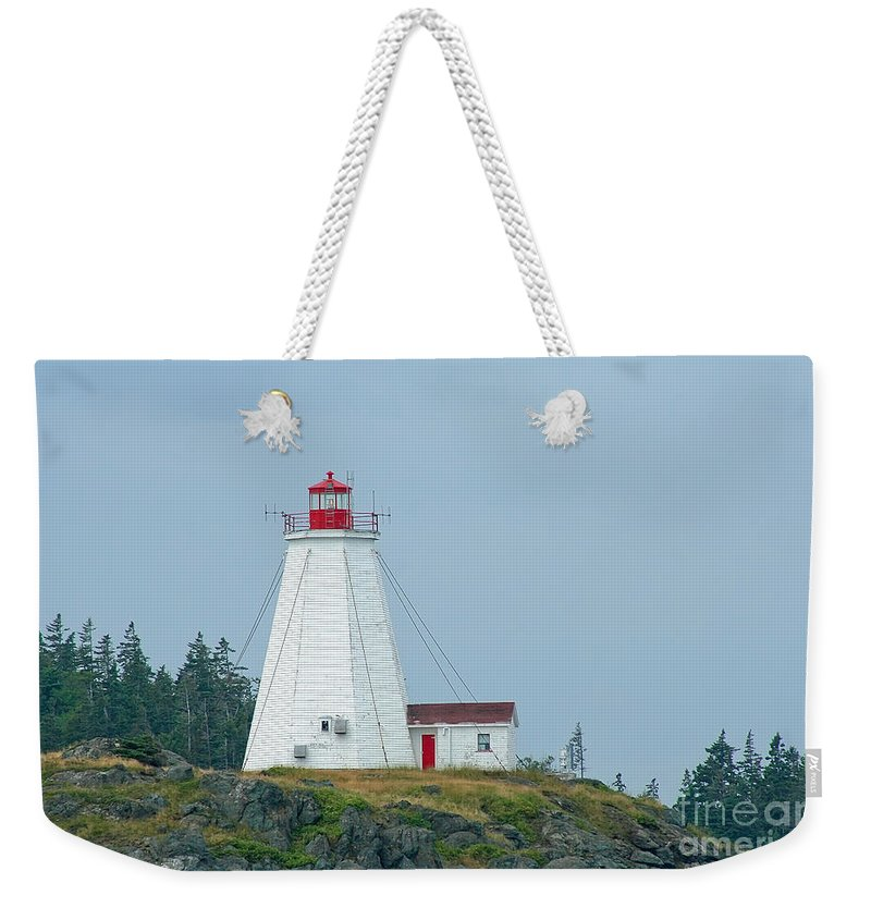 Lighthouse Weekender Tote Bag featuring the photograph Swallowtail Lighthouse by Thomas Marchessault