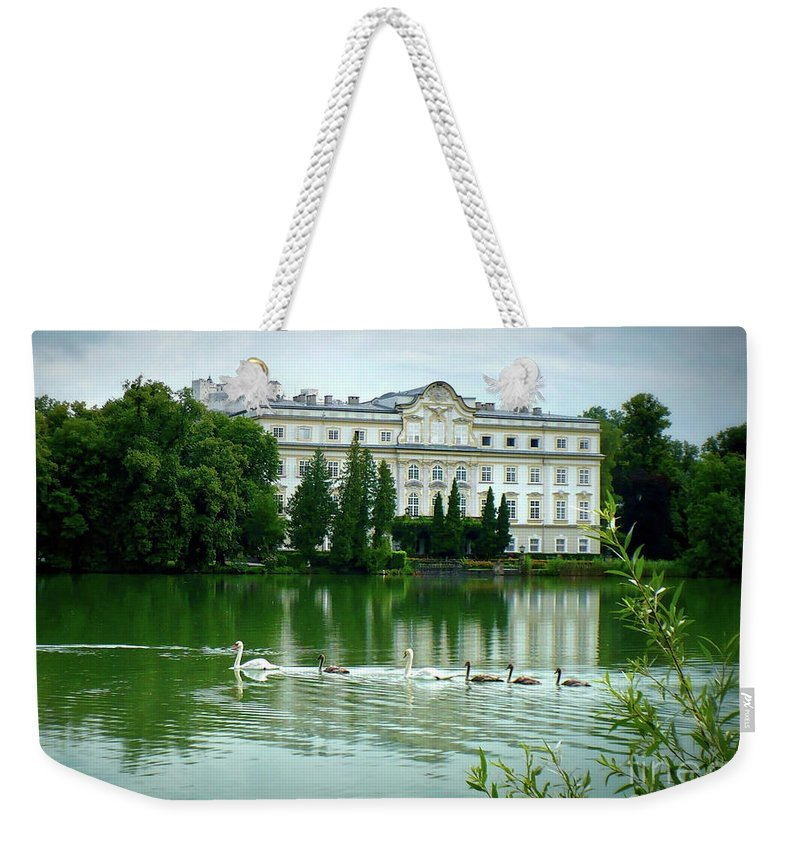 Austrian Lake Weekender Tote Bag featuring the photograph Swans On Austrian Lake by Carol Groenen