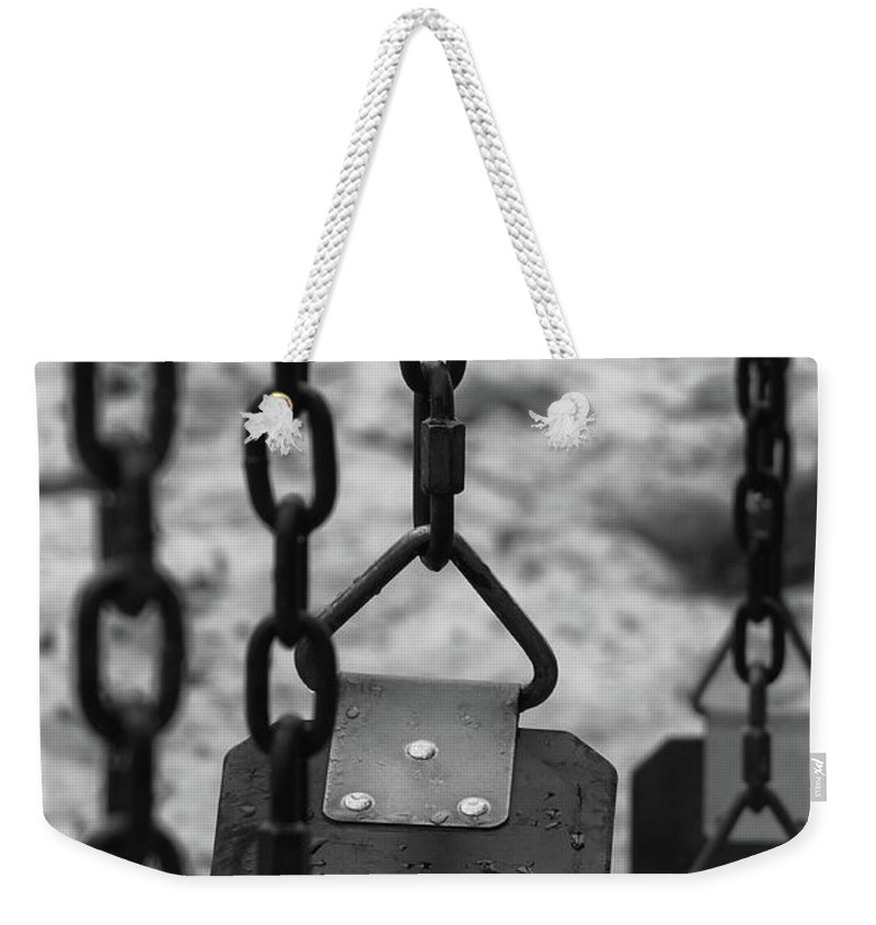 Abstracts Weekender Tote Bag featuring the photograph Swings by Richard Rizzo