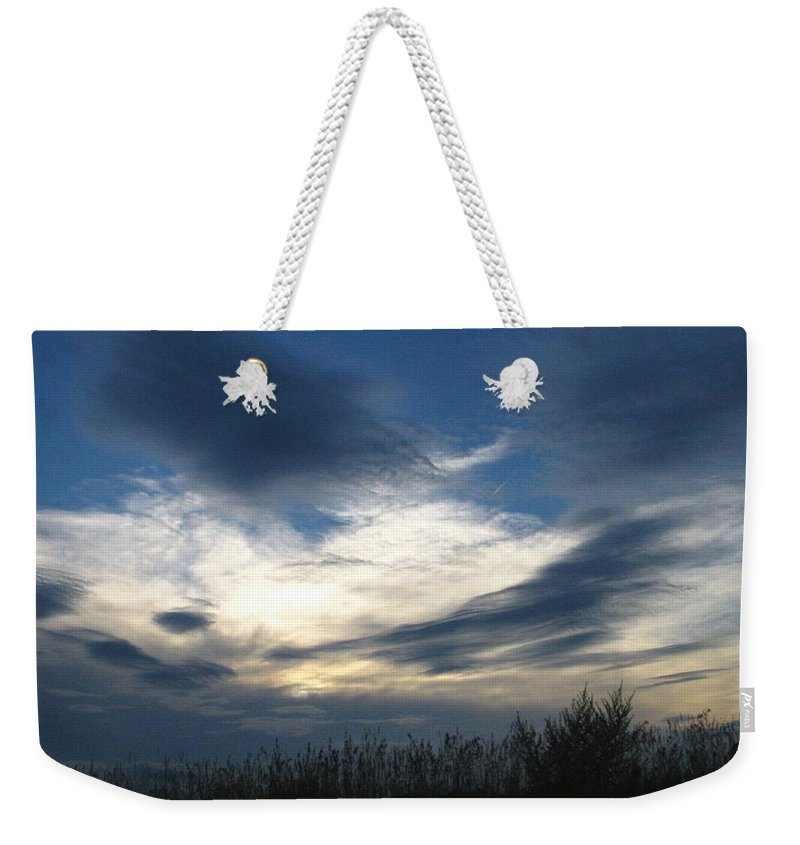 Sky Weekender Tote Bag featuring the photograph Swirling Skies by Rhonda Barrett