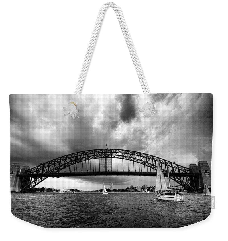 Sydney Harbor Bridge Weekender Tote Bag featuring the photograph Sydney Harbor Bridge Black And White V2 by Douglas Barnard