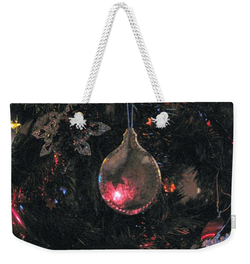 Christmas Weekender Tote Bag featuring the photograph Symbol by Ian MacDonald