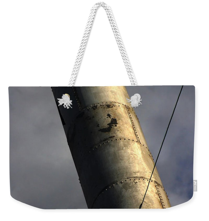 Smoke Weekender Tote Bag featuring the photograph Symbol Of Progress by Jeffery Ball