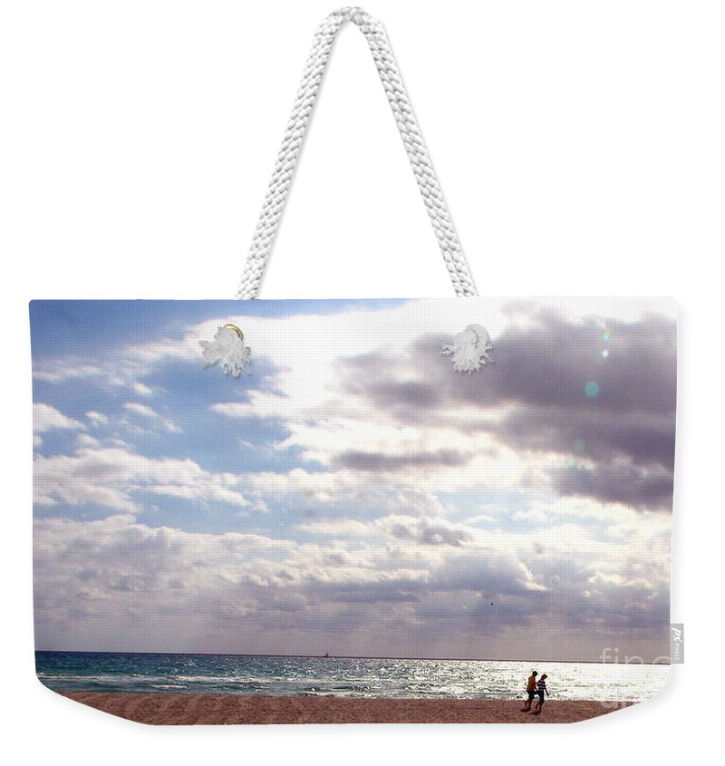 Walking Weekender Tote Bag featuring the photograph Taking A Walk by Amanda Barcon