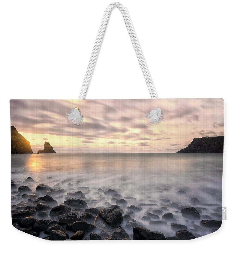 Talisker Bay Weekender Tote Bag featuring the photograph Talisker Bay Boulders At Sunset by Derek Beattie