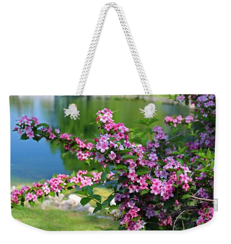 Lake Weekender Tote Bag featuring the photograph Tame A Wild Heart by Michiale Schneider