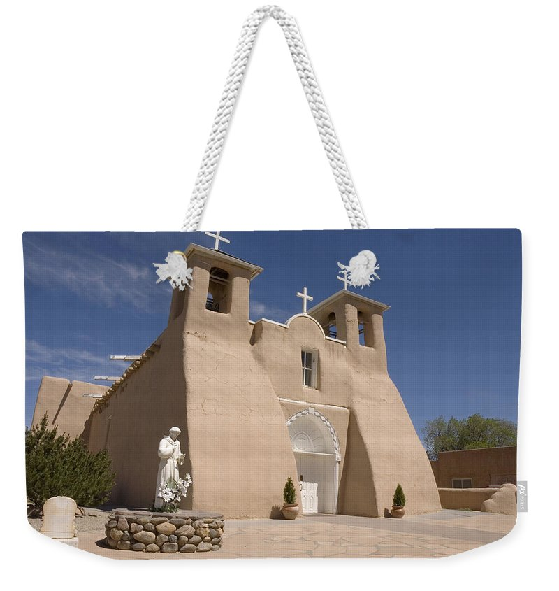 Church Weekender Tote Bag featuring the photograph Taos Landmark by Jerry McElroy