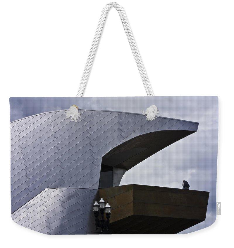 Roanoke Weekender Tote Bag featuring the photograph Taubman Ledge Sculpture Roanoke Virginia by Teresa Mucha