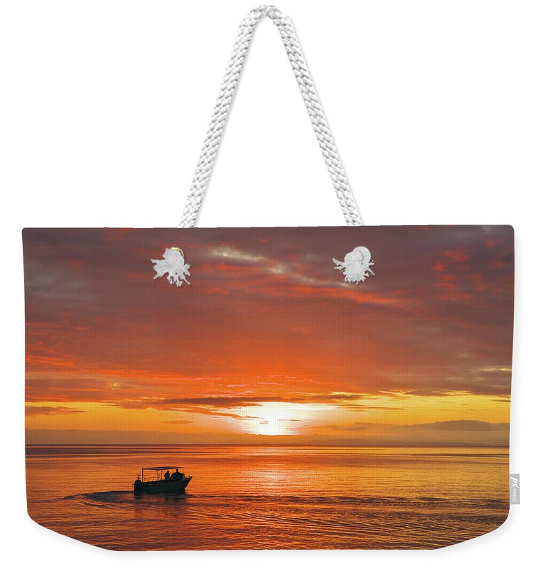Sunset Weekender Tote Bag featuring the photograph Taveuni Sunset by Naoki Takyo