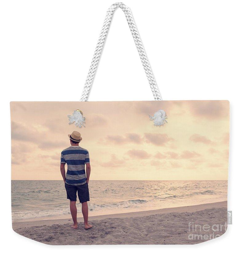 Ocean Weekender Tote Bag featuring the photograph Teen Boy On Beach by Edward Fielding