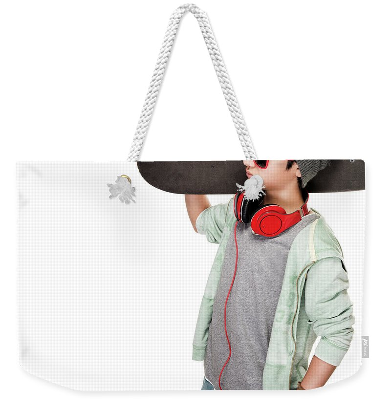 Active Weekender Tote Bag featuring the photograph Teen Boy With Skateboard by Anna Om