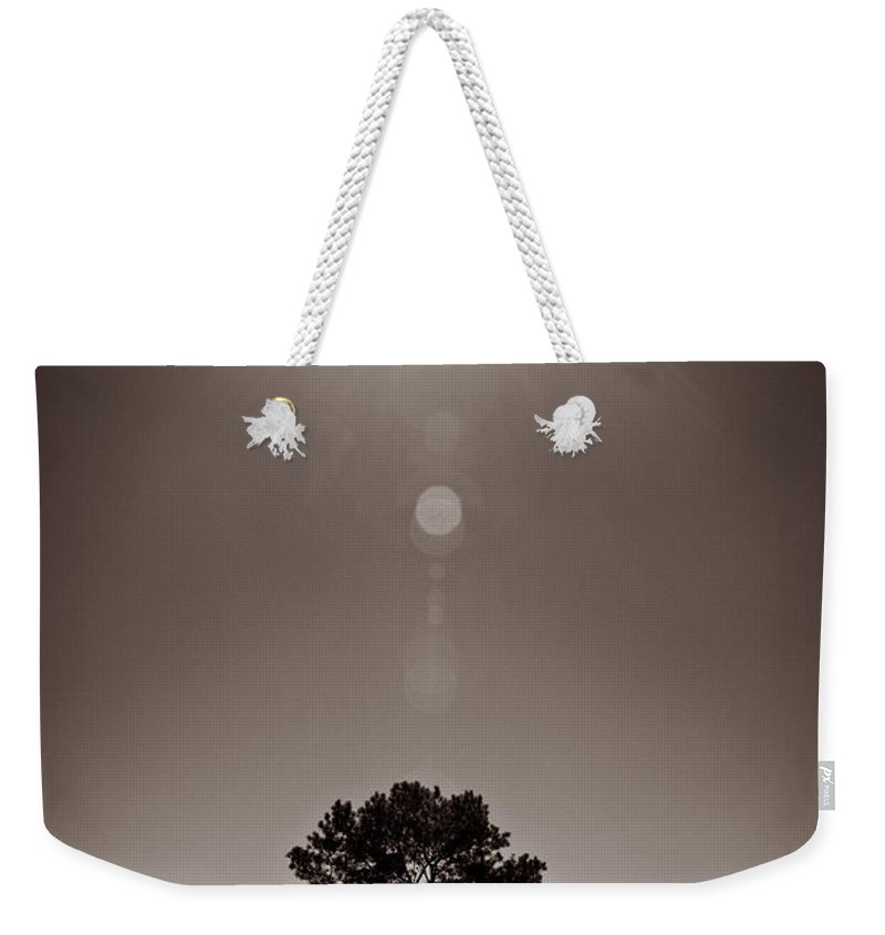 Texas Weekender Tote Bag featuring the photograph Texan Sun by Dave Bowman