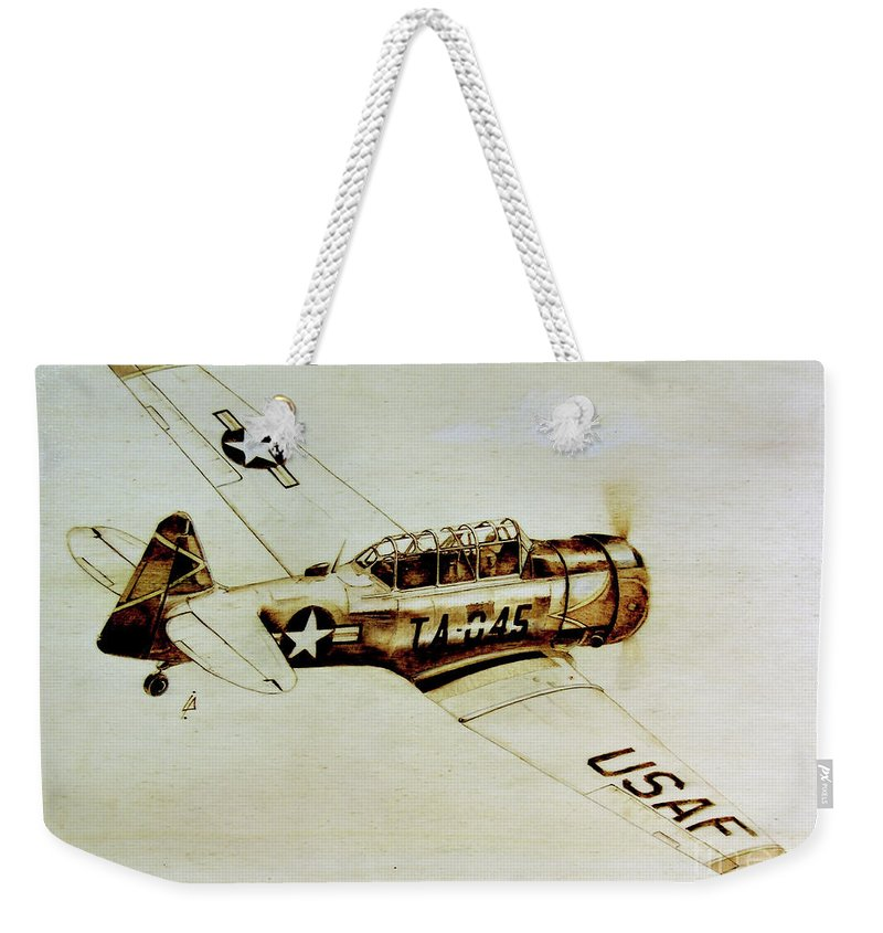 Texan T6 Weekender Tote Bag featuring the pyrography Texan T6 by Ilaria Andreucci
