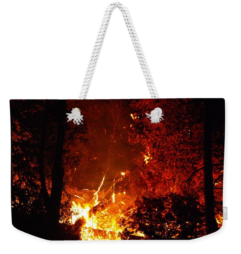 Fire Weekender Tote Bag featuring the photograph That Ain't No Campfire by DeeLon Merritt