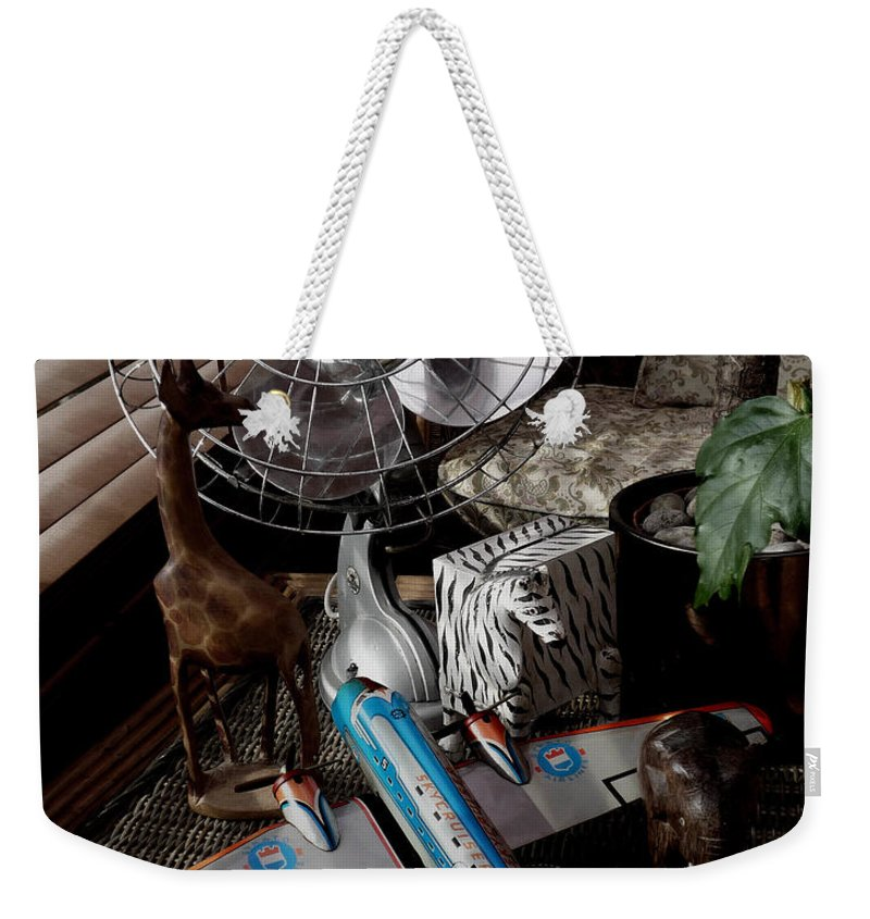 Still Life Weekender Tote Bag featuring the photograph The African Fantasy by Charles Stuart