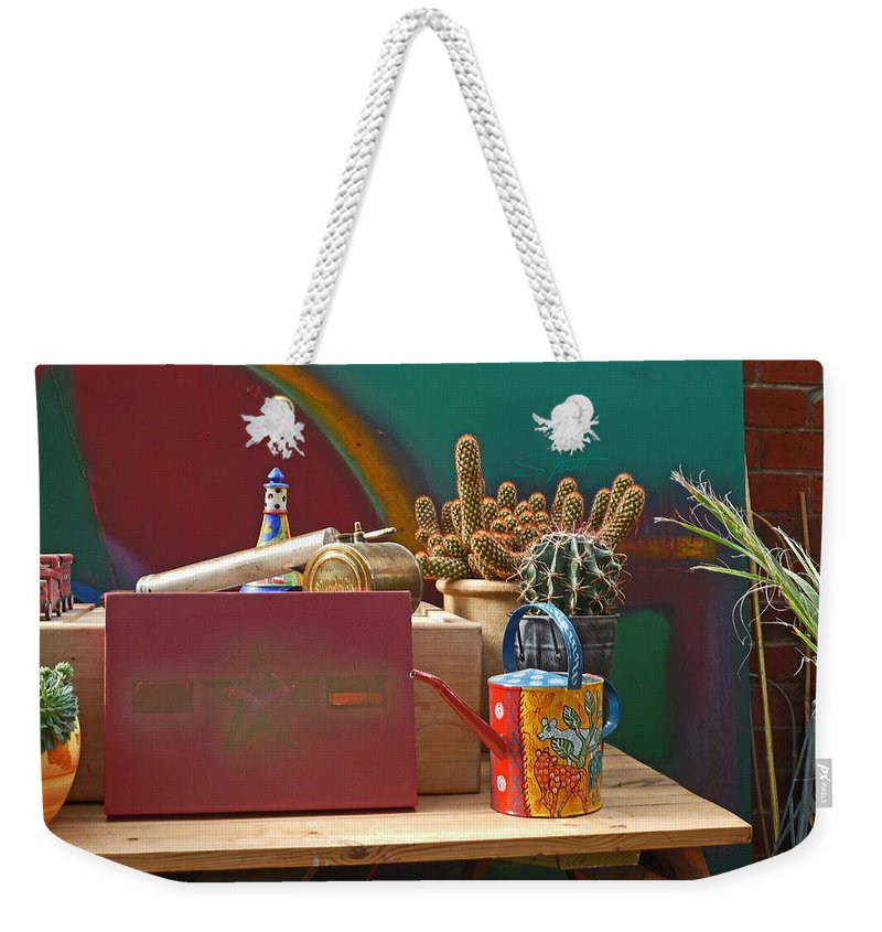 Garden Room Weekender Tote Bag featuring the photograph The African Watering Can by Charles Stuart