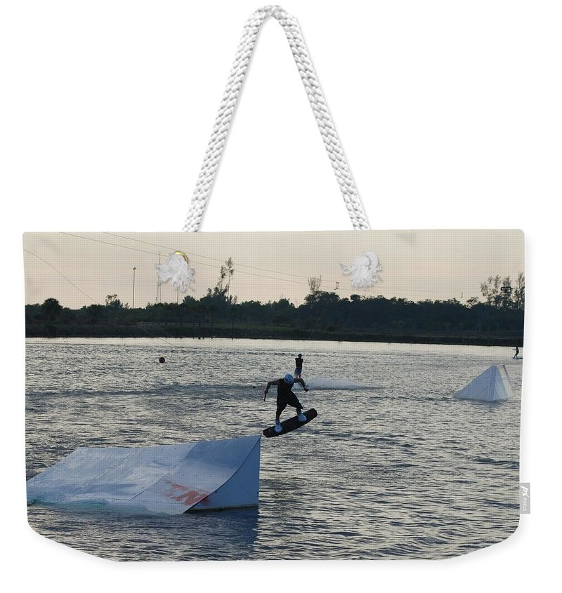 Water Weekender Tote Bag featuring the photograph The After Jump by Rob Hans