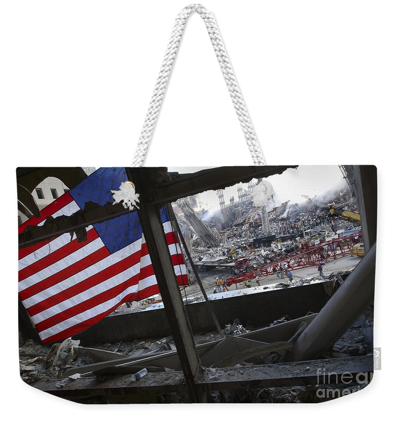 Firefighter Weekender Tote Bag featuring the photograph The American Flag Is Prominent Amongst by Stocktrek Images