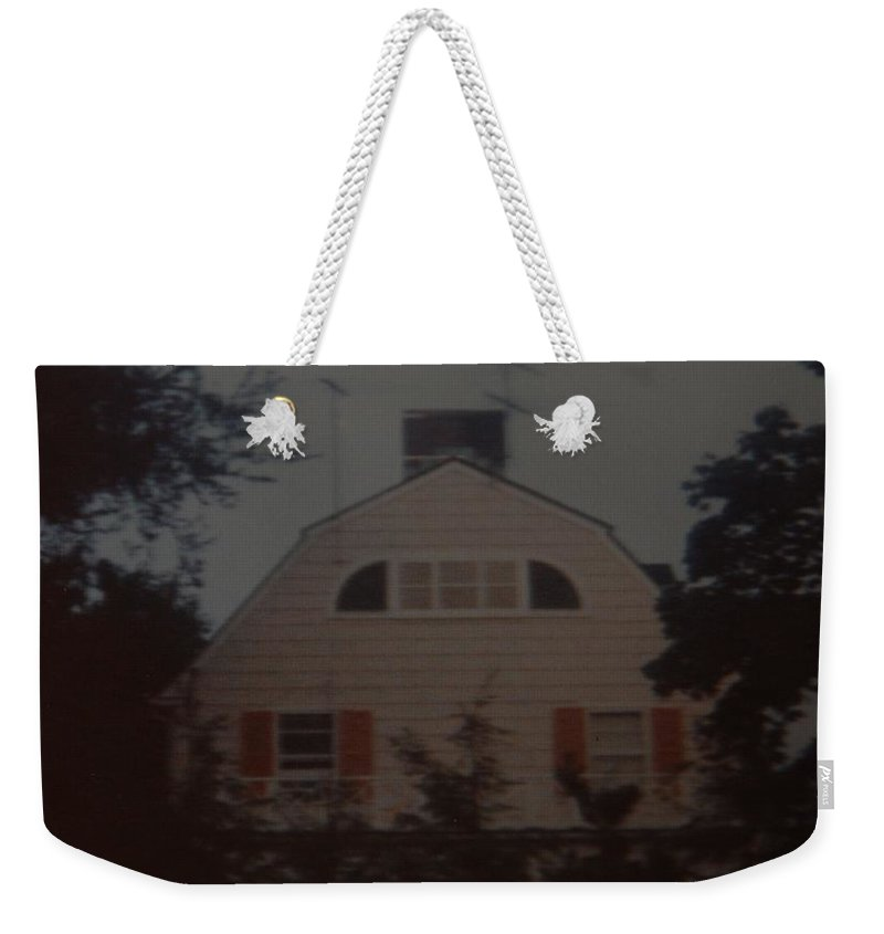 The Amityville Horror Weekender Tote Bag featuring the photograph The Amityville Horror by Rob Hans
