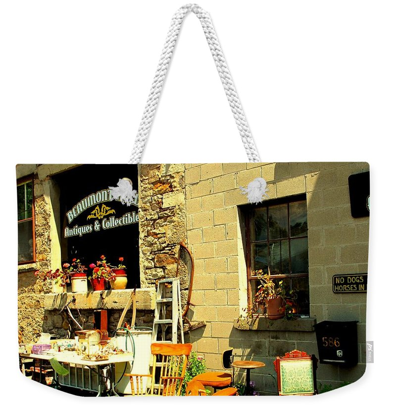 Antique Weekender Tote Bag featuring the photograph The Antique Store by Ian MacDonald