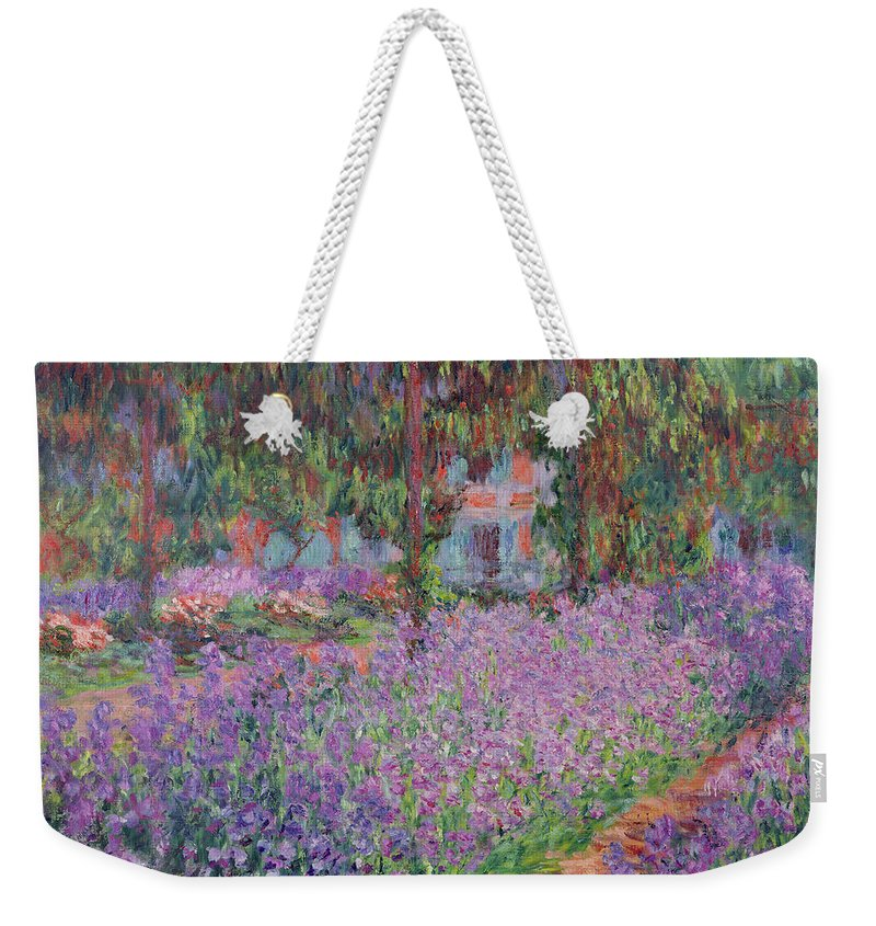The Weekender Tote Bag featuring the painting The Artists Garden At Giverny by Claude Monet