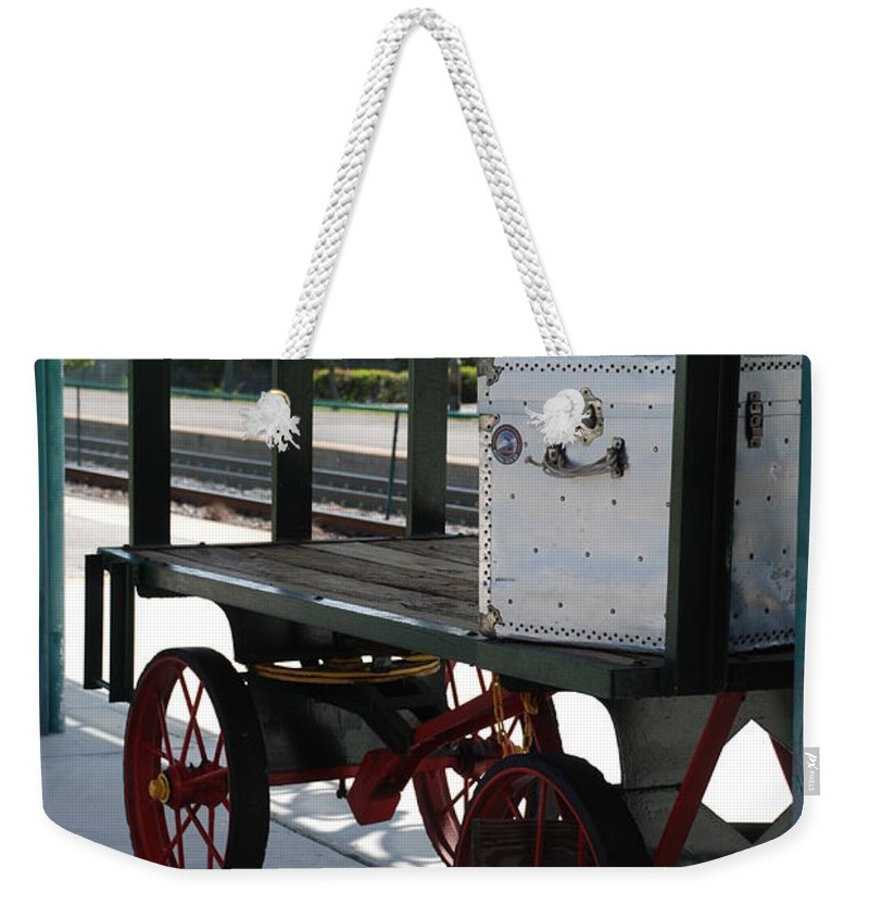 Train Station Weekender Tote Bag featuring the photograph The Baggage Cart And Truck by Rob Hans