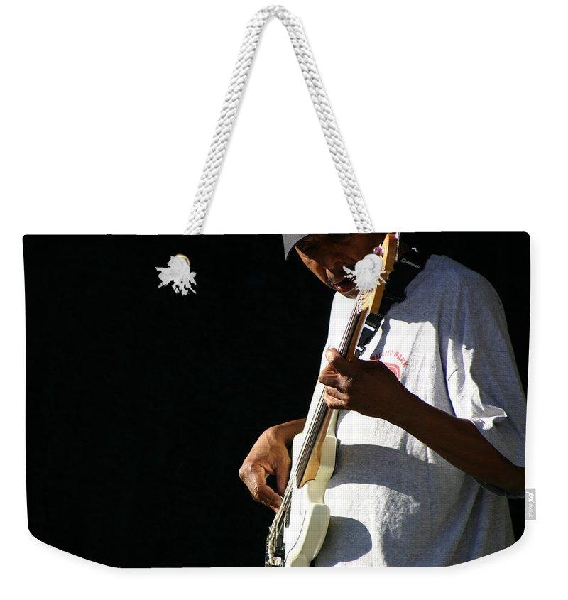 Guitar Weekender Tote Bag featuring the photograph The Bassman by Joe Kozlowski