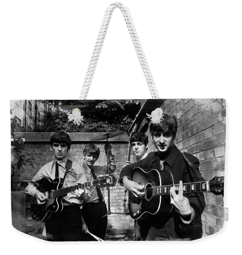 The Beatles Weekender Tote Bag featuring the painting The Beatles In London 1963 Black And White Painting by Tony Rubino