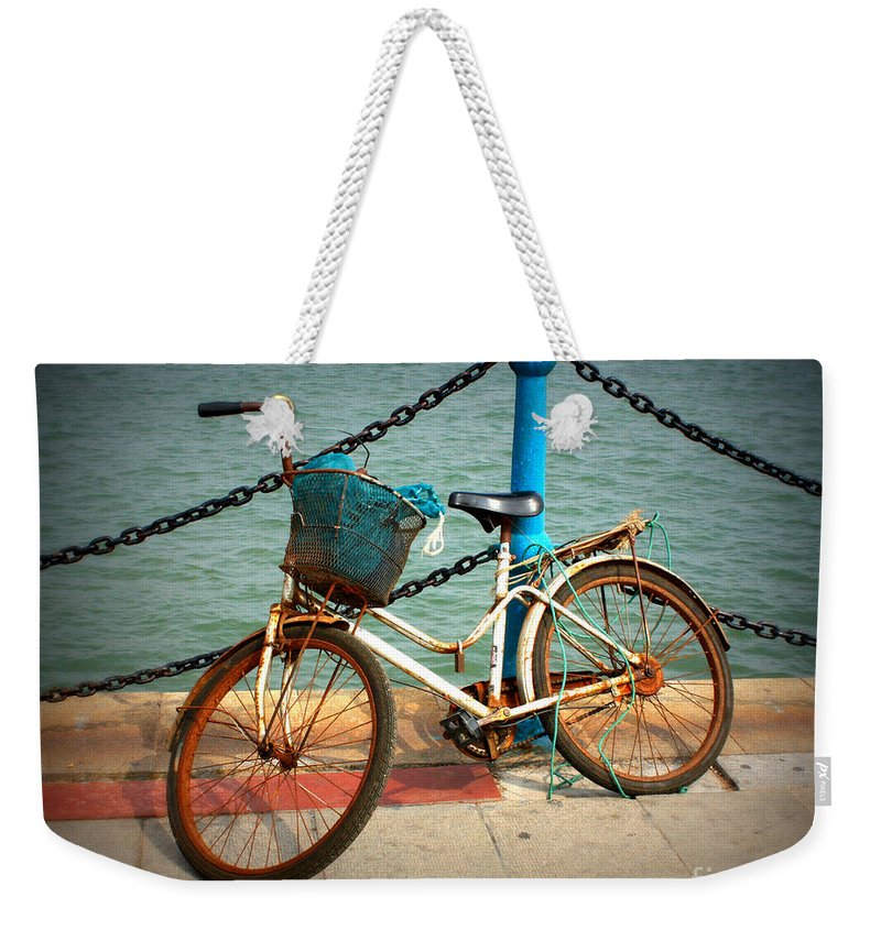 Stories Weekender Tote Bag featuring the photograph The Bicycle by Carol Groenen