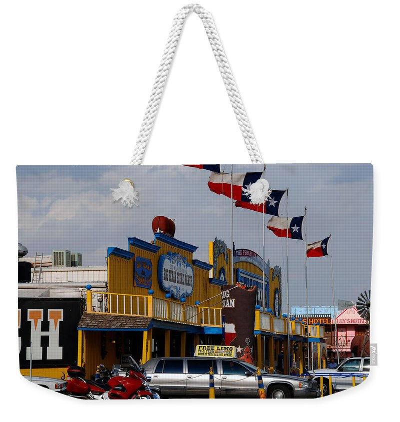 The Big Texan Weekender Tote Bag featuring the photograph The Big Texan In Amarillo by Susanne Van Hulst