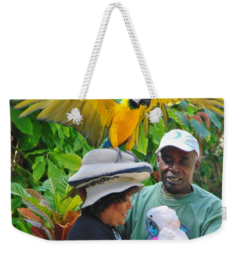 Ardastra Gardens Weekender Tote Bag featuring the photograph The Bird Lady At Ardastra Gardens by Margaret Bobb