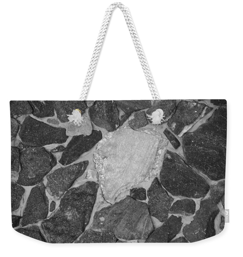 Black And White Weekender Tote Bag featuring the photograph The Black Wall by Rob Hans