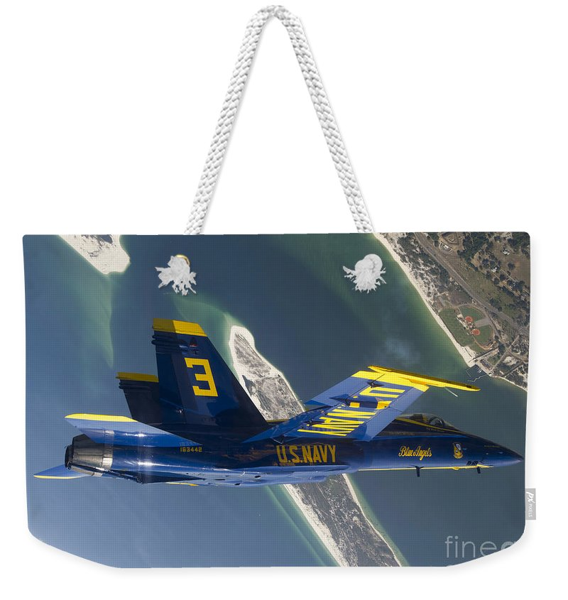Blue Angels Weekender Tote Bag featuring the photograph The Blue Angels Perform A Looping by Stocktrek Images
