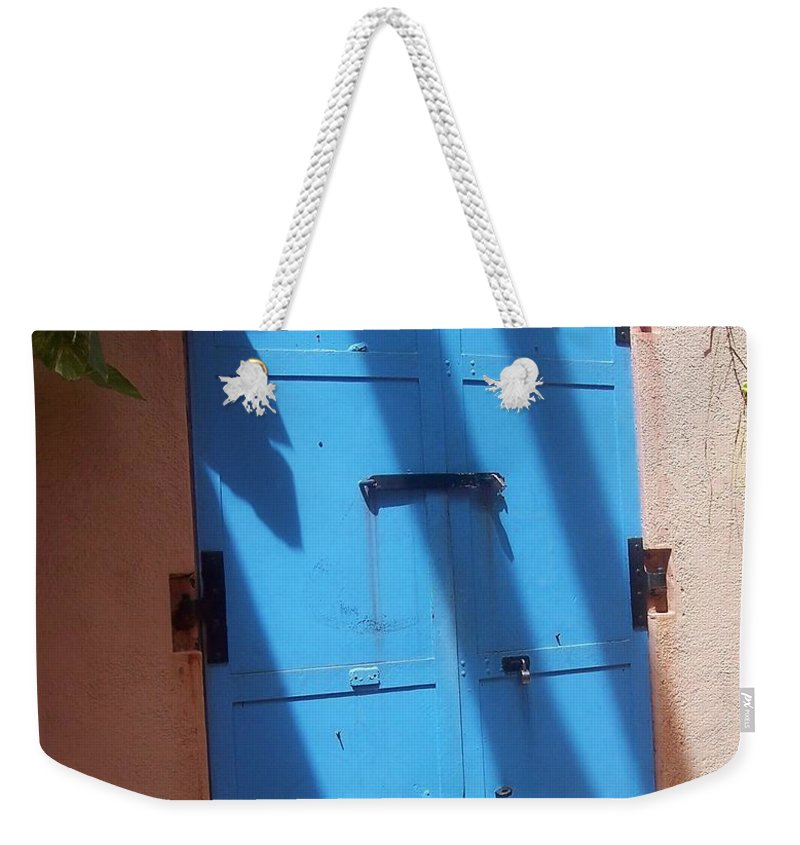 Architecture Weekender Tote Bag featuring the photograph The Blue Door by Debbi Granruth