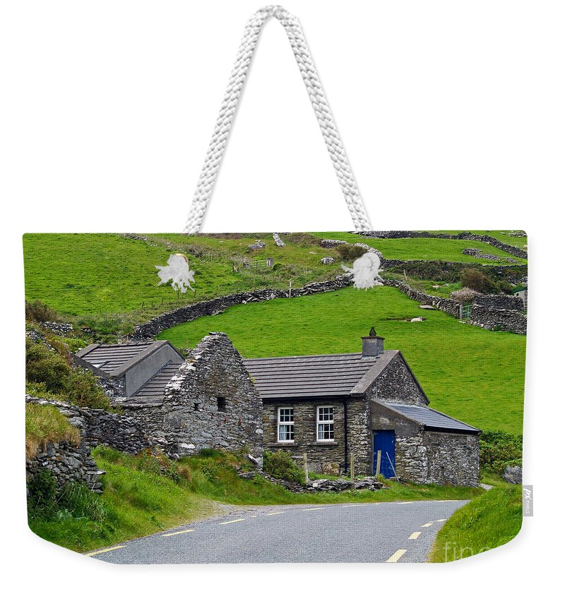Fine Art Photography Weekender Tote Bag featuring the photograph The Blue Door by Patricia Griffin Brett