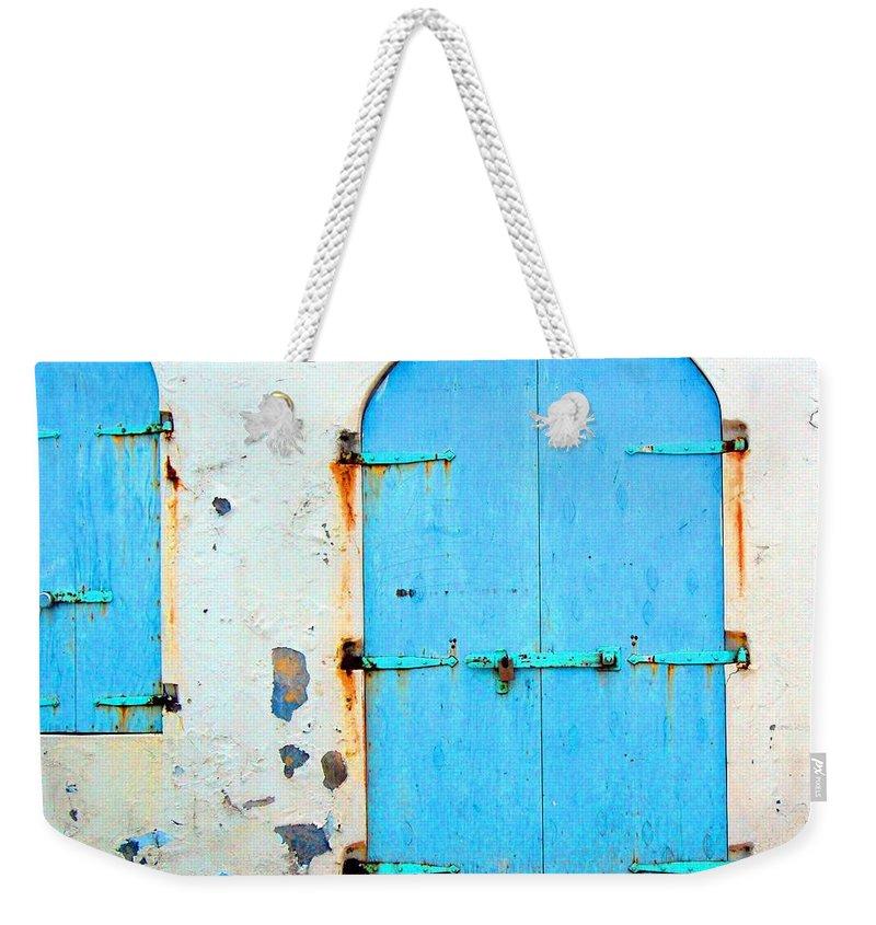 Door Weekender Tote Bag featuring the photograph The Blue Door Shutters by Debbi Granruth