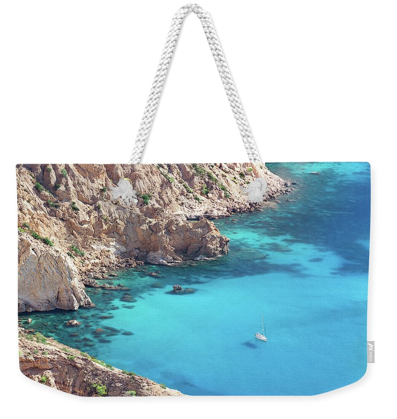 Ibiza Weekender Tote Bag featuring the photograph The Blue Lagoon by Iryna Goodall