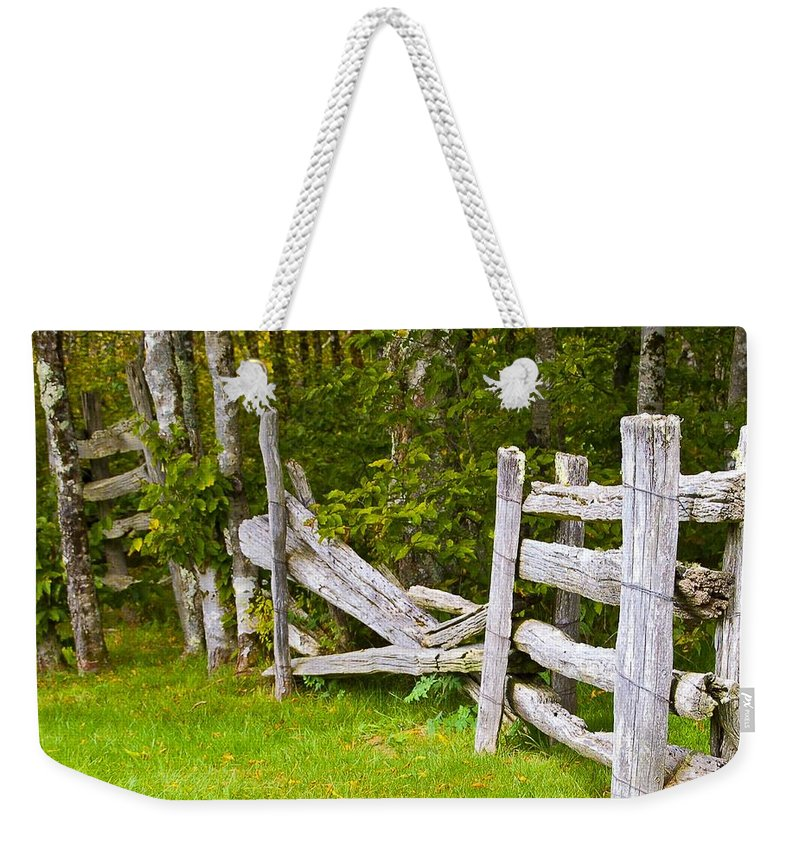 Living Room Weekender Tote Bag featuring the photograph The Broken Barracade by Johnnie Stanfield