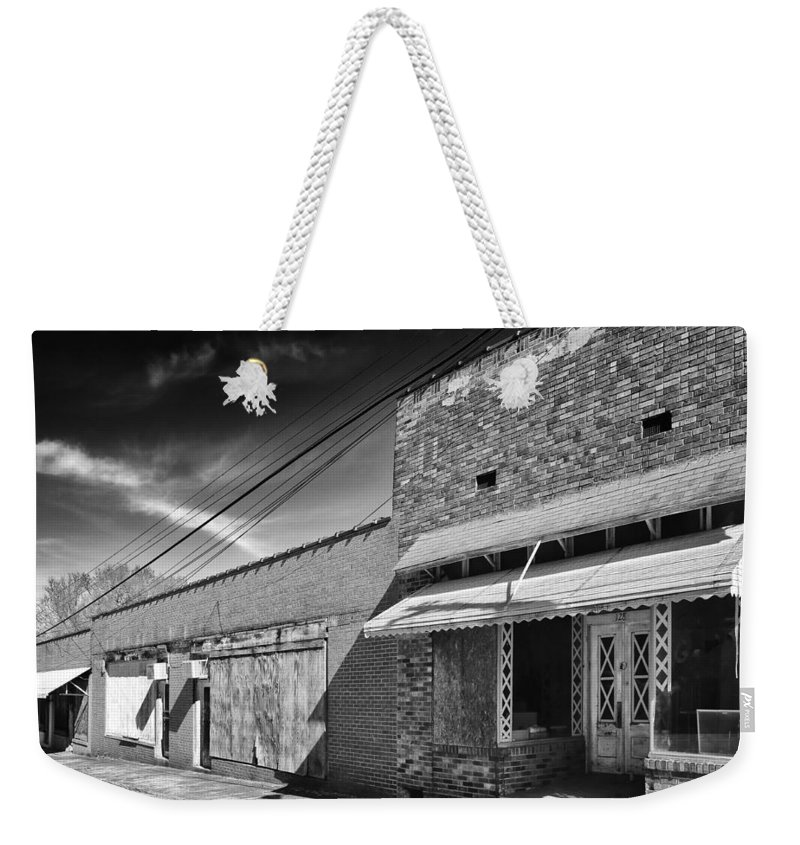 Black-and-white Weekender Tote Bag featuring the photograph The Business District by Dominic Piperata