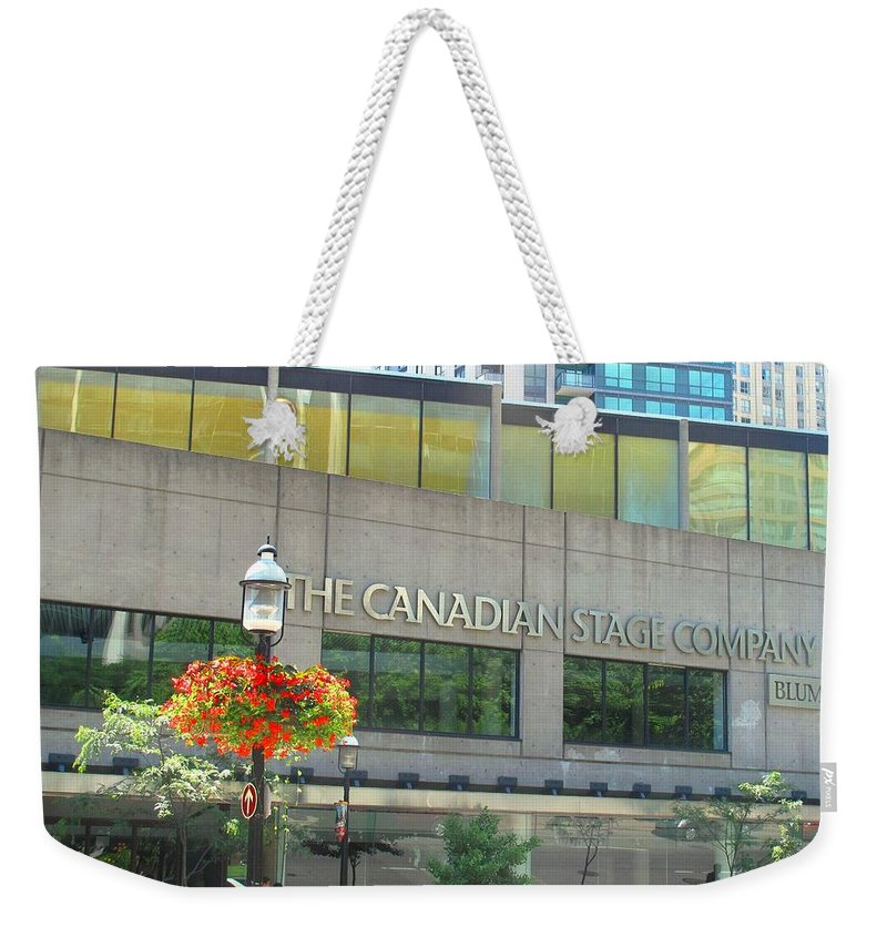 Canada Weekender Tote Bag featuring the photograph The Canadian Stage Company by Ian MacDonald