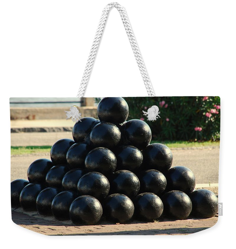 Cannon Balls Weekender Tote Bag featuring the photograph The Cannonballs At The Battery In Charleston Sc by Susanne Van Hulst