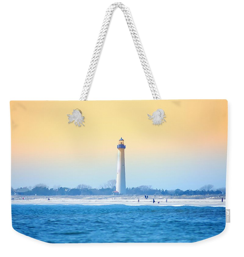 Cape May Weekender Tote Bag featuring the photograph The Cape May Light House by Bill Cannon